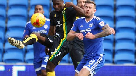 Alex Tettey, pictured battling with Cardiff midfielder Joe Ralls, picked up his 10th booking of the