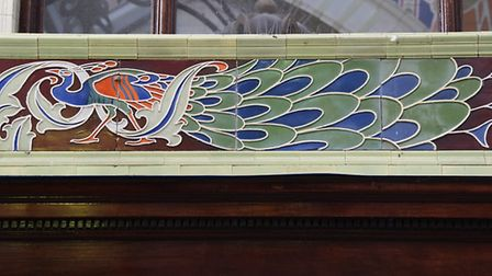 Painted ceramic tiles in parianware of a peacock in the Royal Arcade. Picture: DENISE BRADLEY