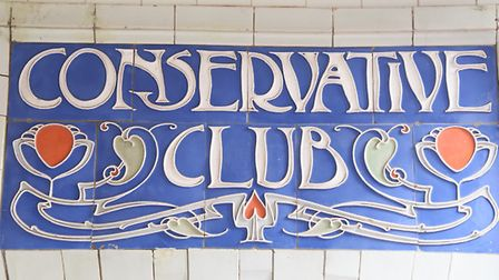 Painted ceramic tiles in parianware making the often missed sign in the Royal Arcade. Picture: DENIS