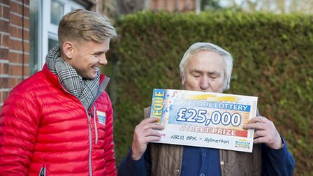Rodney Taylor kissed the cheque when he realised how much he�d won. Picture: DUSTIN SMITH/SKYWALL PH