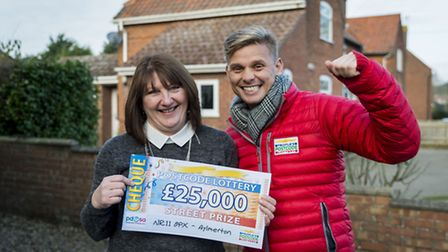 Katherine Well receives her prize from People�s Postcode Lottery Ambassador, Jeff Brazier. Picture: