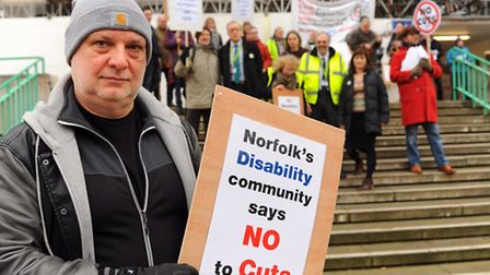 Mark Harrison, front left, chief executive of Equal Lives,attends a previous protest over cuts for t
