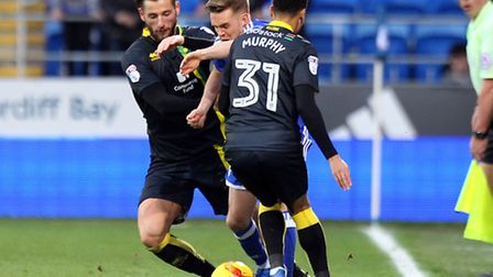 Mitchell Dijks of Norwich and Josh Murphy of Norwich combine to stop Craig Noone of Cardiff City dur