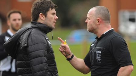 Harleston Town manager, Adam Gusterson faces referee Paul Stearman during the match with Stalham. Pi
