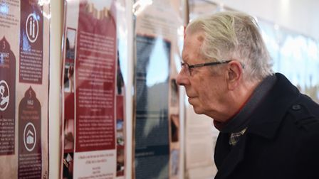 Visitors study the information about the Islam faith at the open day at the Norwich Central Mosque.