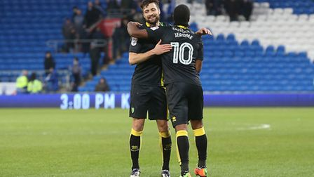 Russell Martin and Cameron Jerome embrace at full time after earning victory in Cardiff. Picture: P