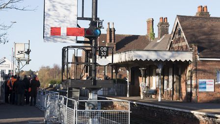 A new signal is put into operation at Oulton Broad North station to help improve the level crossing.