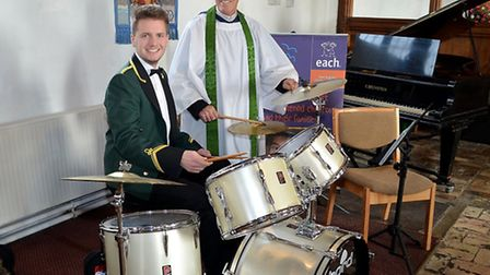 Band timpanist Simon Warren giving drumming advice to Canon Bob Baker the Rector of Pakefield Church