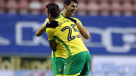 Nelson Oliveira celebrates opening the scoring for Norwich City at Wigan . Picture: Paul Chesterton/