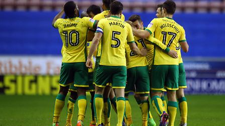 Nelson Oliveira's Norwich City team-mates join in with the celebrations - but in the end, they had t