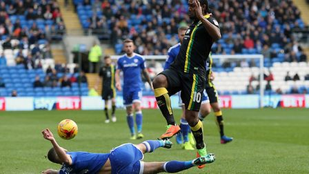 Cameron Jerome of Norwich and Ashley Richards of Cardiff City in action during the Sky Bet Champions