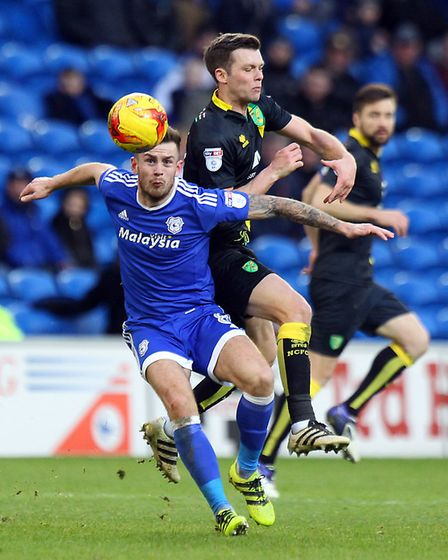 Joe Ralls of Cardiff City and Jonny Howson of Norwich in action during the Sky Bet Championship matc