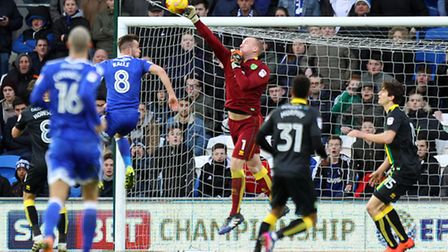 John Ruddy punches clear to help preserve his clean sheet during Norwich City's 1-0 win at Cardiff.