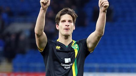Timm Klose of Norwich gives a thumbs up to the travelling support at the end of the Sky Bet Champion