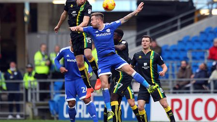 Timm Klose was dominant in the air for Norwich during their win at Cardiff . Picture by Paul Chester