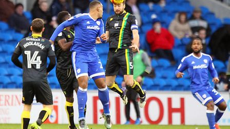 Russell Martin of Norwich wins a header during the Sky Bet Championship match at the Cardiff City St