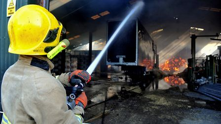 Firefighters tackle the farm fire at Metfield.