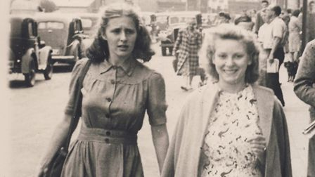 Brenda Hare (right) as a young woman with her friend Valerie in Church Street Cromer. Picture: DIANA