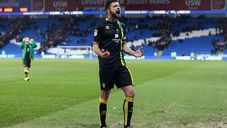 Russell Martin of Norwich celebrates victory at the end of the Sky Bet Championship match at the Car