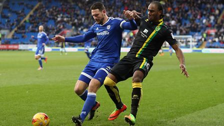 Sean Morrison of Cardiff City and Cameron Jerome of Norwich in action during the Sky Bet Championshi