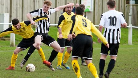 Kurtis Callaby in the thick of the action during Swaffham Reserves' 5-1 win over Freethorpe in the A