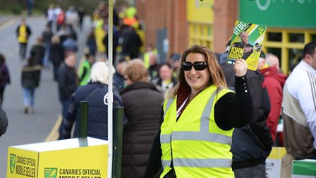 A programme seller ahead of the NCFC v Ipswich Town FC derby match.Picture: ANTONY KELLY