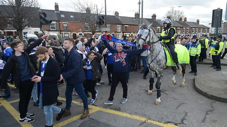 Police usher Ipswich fans away from the ground after the NCFC v Ipswich Town FC derby match.Picture