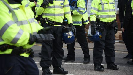 NCFC v Ipswich Town FC derby match. Police pictured with their riot gear at the ready after the matc