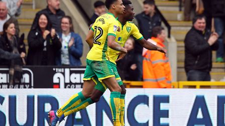 Jacob Murphy celebrates scoring Norwich City's derby day equaliser with Alex Tettey. Picture: Paul C
