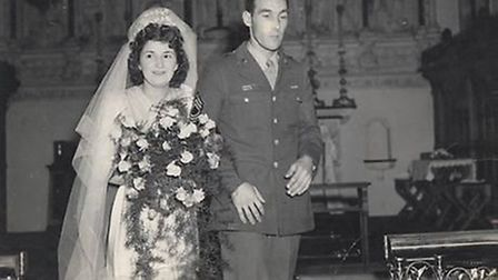 Can you help identify this bride and groom? The mystery wedding photo from 100th Bomb Group Memorial
