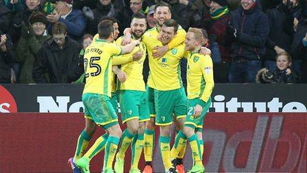 Jonny Howson takes the applause after his incredible goal to open the scoring at Carrow Road. Pictur
