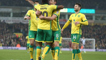 Cameron Jerome gets a hug from Jonny Howson after putting the Canaries ahead against the Championshi