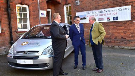 Unveiling of the Veterans' Response Partnership car. Left, director of the Walnut Tree Project Luke