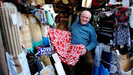 Barry Read on his fabric stall at Norwich Market, backing the Love Local campaign. Picture: Denise B