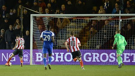 Lincoln's Nathan Arnold scores in the final minutes of the FA Cup replay against Ipswich at Sincil B