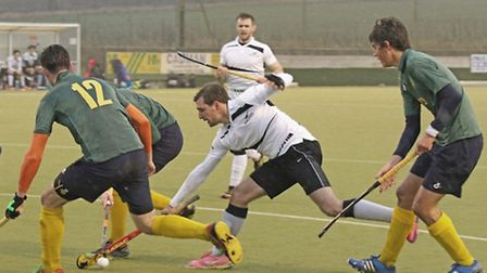 Ben Wright in the thick of the action for Harleston Magpies' during Saturday's amazing 5-5 draw agai