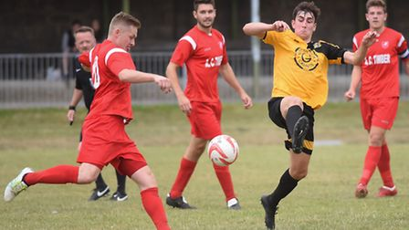 Action from the Thurlow Nunn Premier Division match, Great Yarmouth Town (yellow/black) V Ely City.