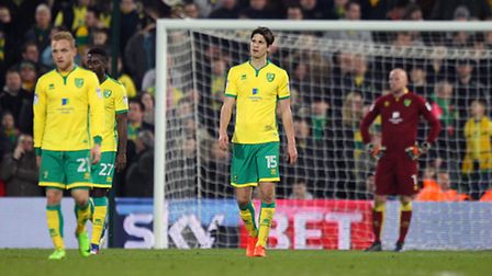 The Norwich players look dejected after conceding a second goal. Picture by Paul Chesterton/Focus I