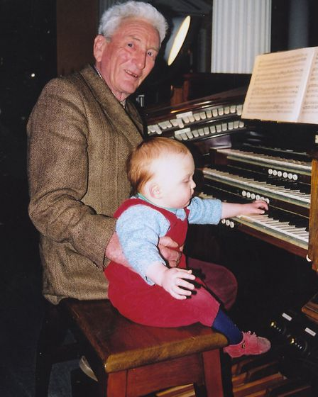 Ronald Buxton and a grandson, Rupert Warre, seated at an organ. The instrument is at Kimberley (It w