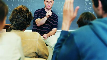 Teacher in a classroom of students. Picture: Thinkstock