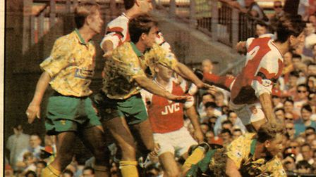 Mark Robins stoops to score at Arsenal in 1992.