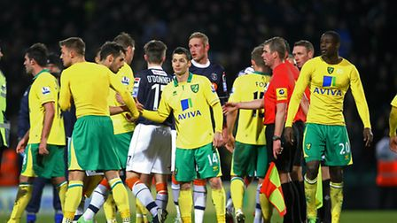Handshakes all round , but it's unwanted FA Cup history for Norwich as they lose to non-league Luton