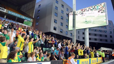 Home fans in the Barclay Stand watching the big screen.