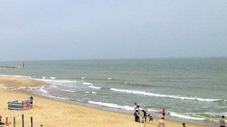 People enjoying themselves in the hazy sunshine & fresh breeze at Caister Beach, Great Yarmouth. Pic