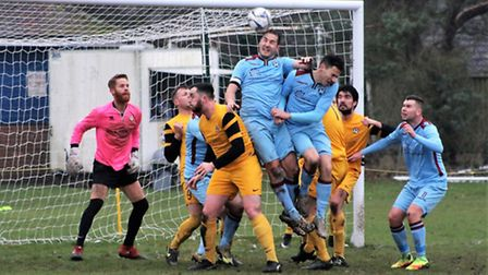 Goalmouth action from the Anglian Combination Premier League match between Waveney and visitors Spix