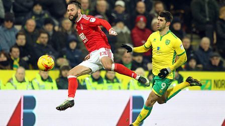 Danny Fox of Nottingham Forest and Nelson Oliveira of Norwich in action during the Sky Bet Champions