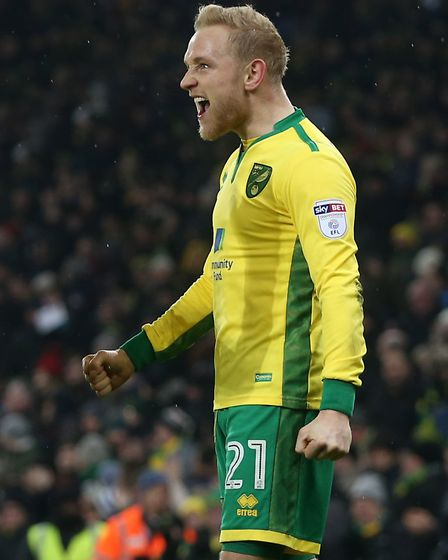 Alex Pritchard of Norwich celebrates scoring his sides 5th goal during the Sky Bet Championship matc