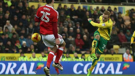 Alex Pritchard of Norwich sees his shot blocked by Jack Hobbs of Nottingham Forest during the Sky Be