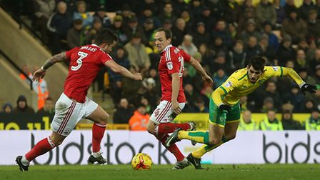 Nelson Oliveira of Norwich is fouled by David Vaughan of Nottingham Forest during the Sky Bet Champi