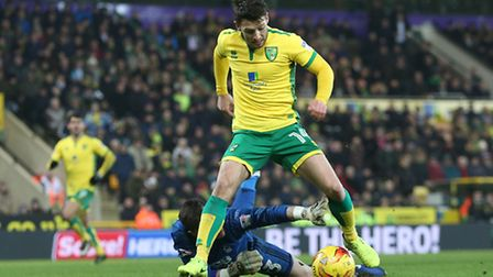 Wes Hoolahan of Norwich goes round Jordan Smith of Nottingham Forest but can't quite get his shot or